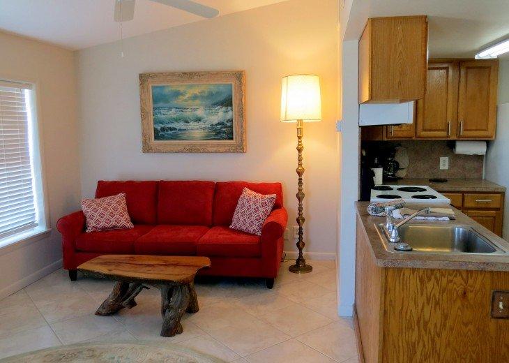 Sofa and kitchen.