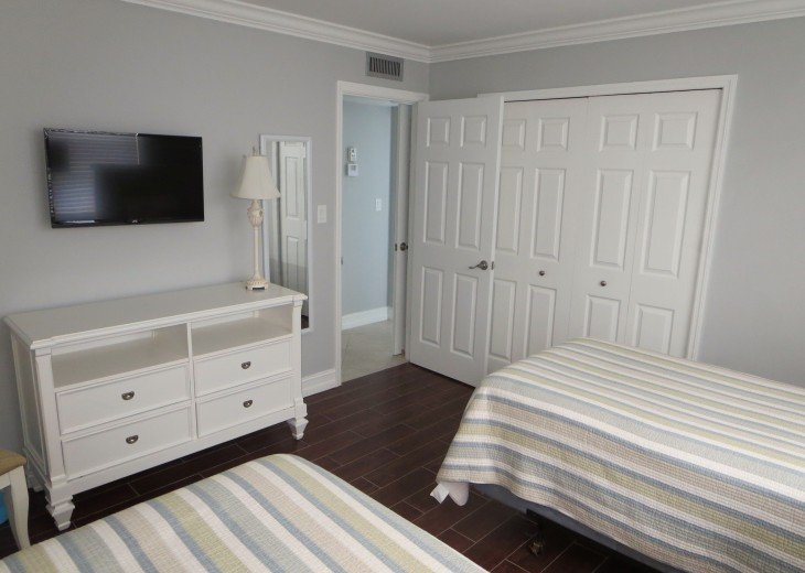 """Both bedrooms have 32"""" wall mounted LCD TV's crown molding and tile floors."""