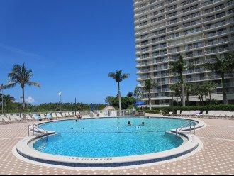 Enjoy the wonderful Heated Pool with plenty of lounge chairs & umbrella's!