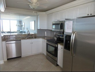 Never miss a conversation and always enjoy the Gulf View from the Kitchen