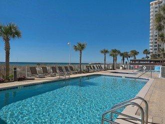 Outdoor pool, hot tub, indoor/outdoor pool -- plenty of seating