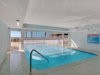 Indoor/outdoor pool is seasonally heated for year round comfort