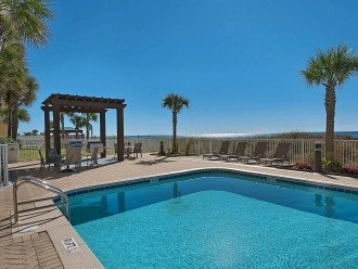 Outdoor pool, gas grills and lanai with dining area