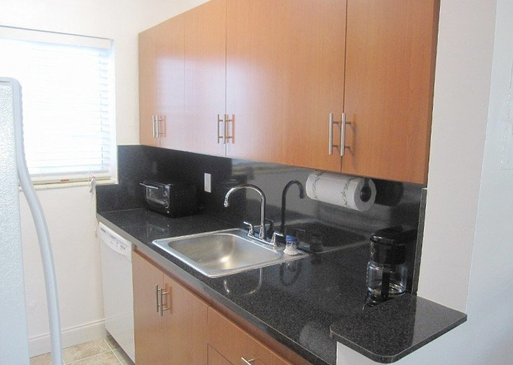 Full kitchen includes coffee maker, toaster, glass ware, plates, pots/pans