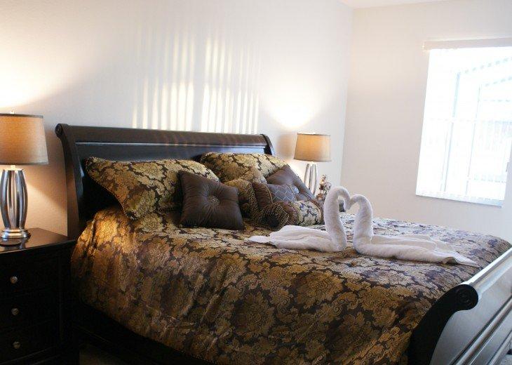 Master King bed 1 - sliding doors onto pool area