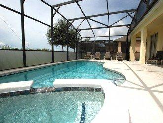 Pool area with alfresco dining under Lanai