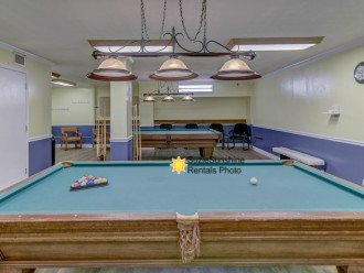 Game Room with pool tables and tvs