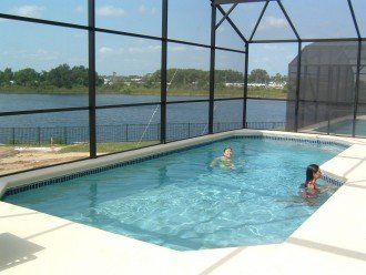 South facing pool area with view of lake