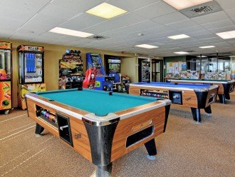 Game room with arcade games and pool tables