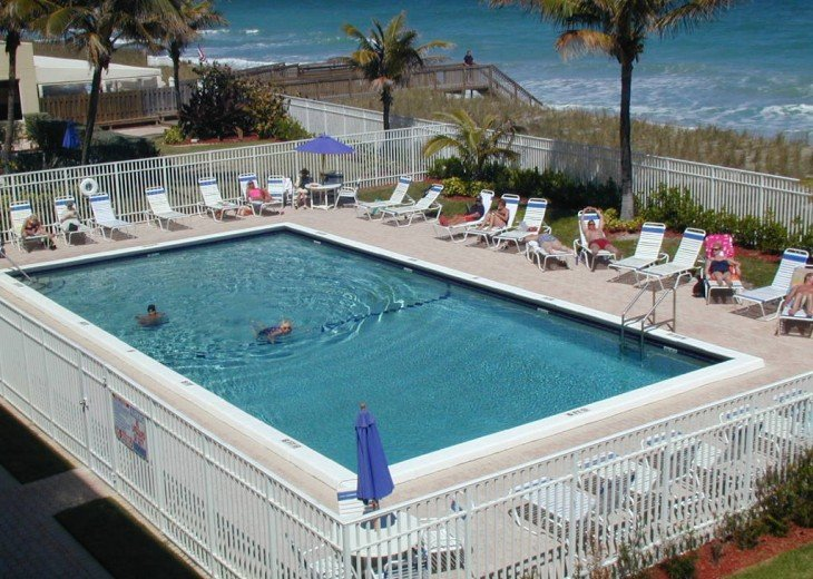Guests love sun bathing by the pool. Some even go in the heated water.
