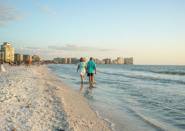 Take a Walk Along Crescent Beach's White Sand and Crystal Blue Water