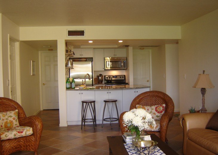 Open to the great room, the fully equipped kitchen has a granite breakfast bar