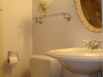 The renovated full 2nd bathroom has a Kohler sink, toilet and walk-in shower.