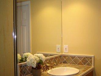 The ensuite master bathroom has Kohler fixtures, ceramic tile and walk in shower
