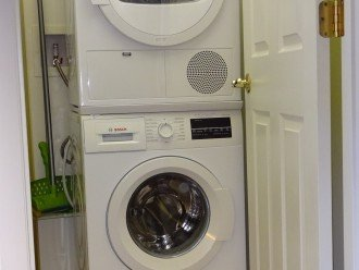 There is a new Bosch washer/dryer in the laundry room within Siesta Key 611.