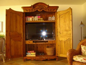 The entertainment armoire has a 46'' flat screen TV, DVDs, books and games.