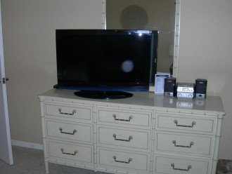 "Guest bedroom 32"" TV, DVD player, CD player, and dresser"