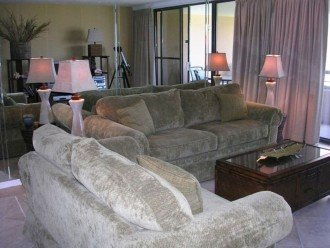 Professionally decorated Living Room with pull out sofa bed and opens to balcony