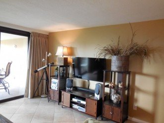 "Living Room w/ 50"" TV, DVD player, Stereo, books and videos for your enjoyment"