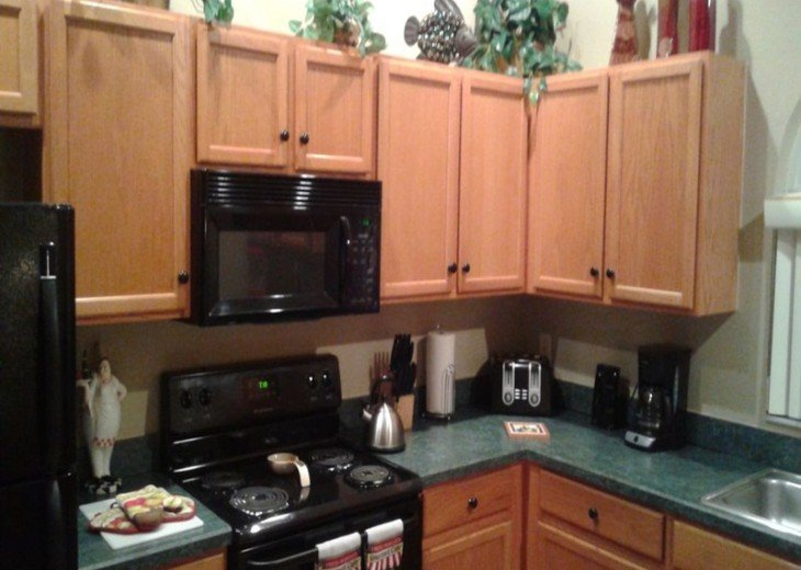 The kitchen is fully stocked with all the necessary appliances.