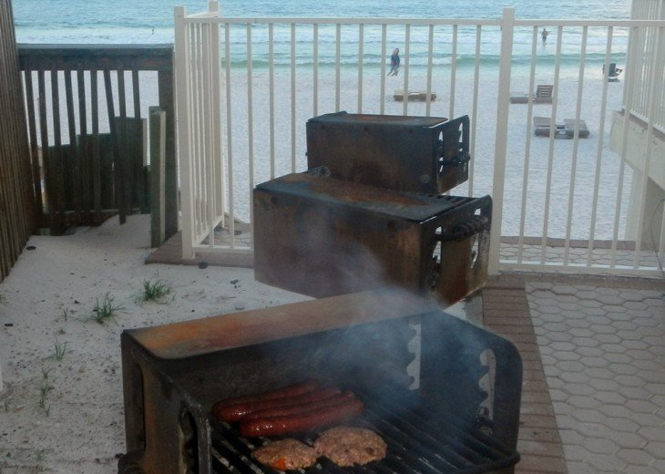 3 BBQ Grills on the pool deck on the beach