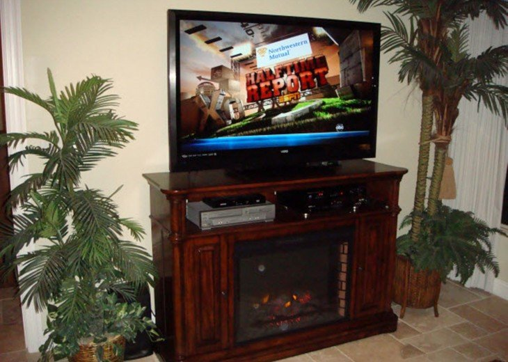 "55"" Big Screen LCD Vizio 1080p HD TV in the Great Room with fireplace"