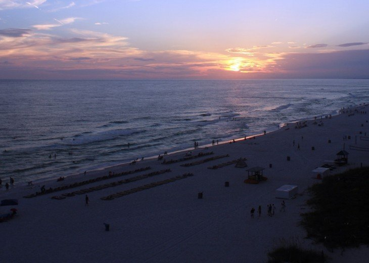 View from 802 sq ft wrap around balcony overlooking Gulf of Mexico at sunset