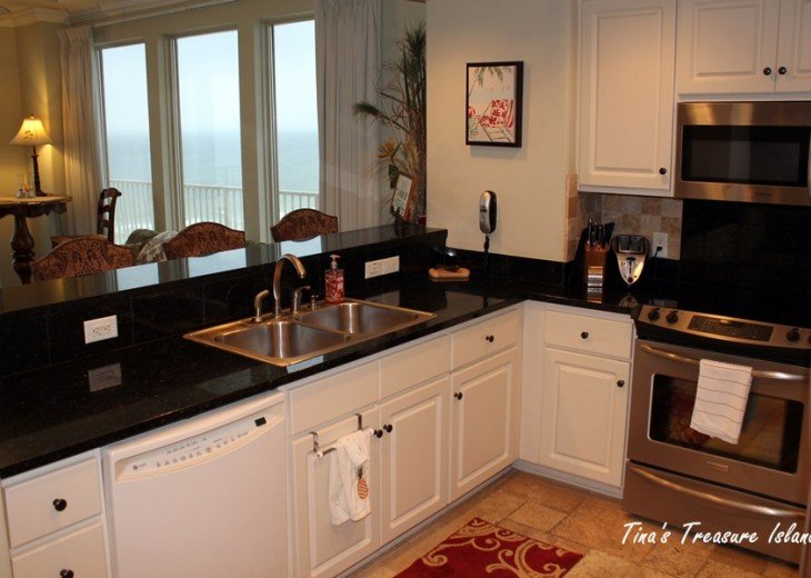 Kitchen with stainless steel appliances, granite counter tops