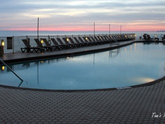 120 ft long heated pool at sunset
