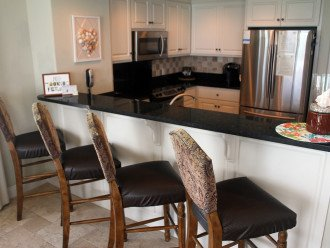View of our Kitchen with stainless steel appliances, granite counter tops