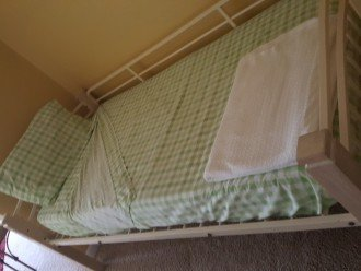 Twin bed in bunk area.