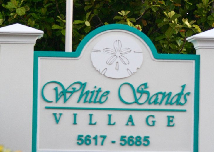 Welcome to White Sands, your building is 5683 Midnight Pass Road