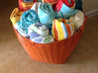 Basket of beach towels and garage filled with beach gear and bikes for your use.