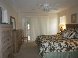 King bedroom with full bath, balcony and new bed with furniture