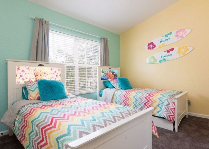 Kids bedroom - 2 twins and a twin trundle bed.