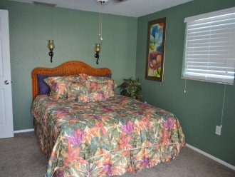 Master bedroom with queen bed and walk out to pool