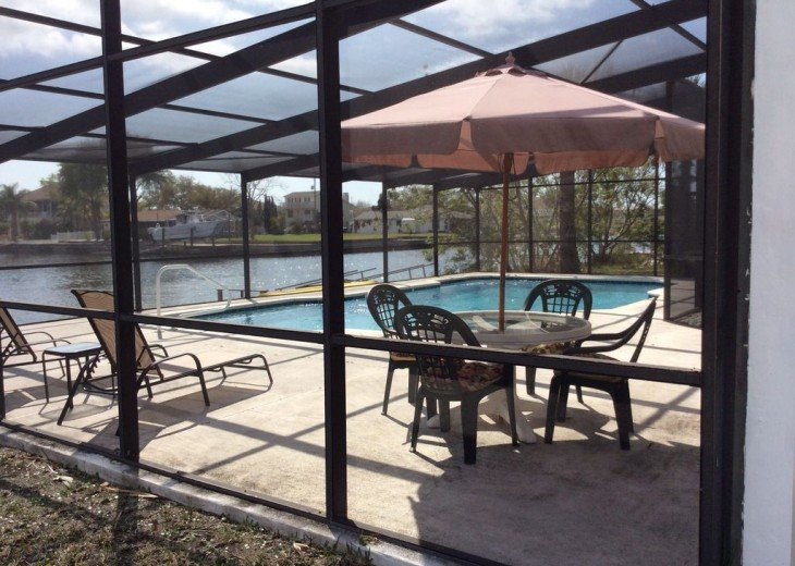 Beautiful 3 BR stilt home surrounded by water. The charm of Old Florida awaits #4