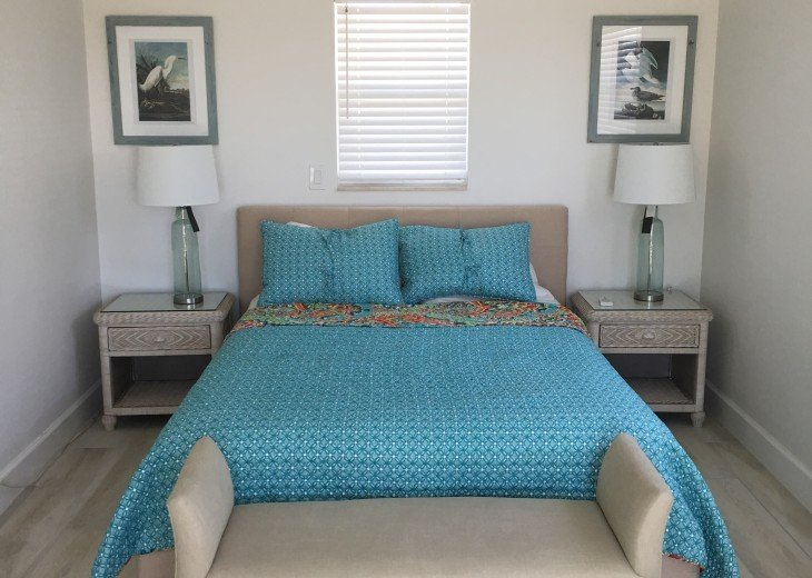Recently renovated bedroom with gulf view through patio doors