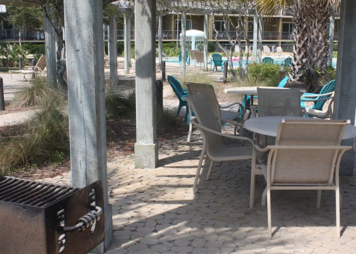 Lots of grills and shaded poolside sitting for your family enjoyment