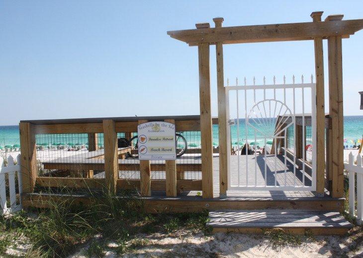 A very short stroll along a wide pedestrian walk to 300 feet of private beach