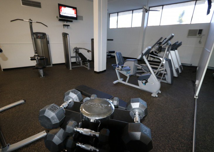 Gym is open 24/7, located on main floor of building