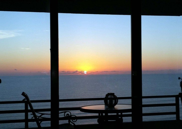 Quiet sunrise overlooking the ocean from the wrap around balcony