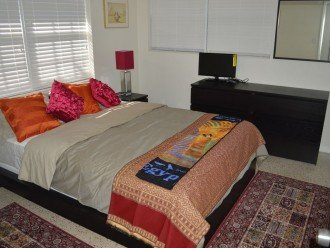 The guest bedroom also has a queen sized bed, ample closets and a smart TV.