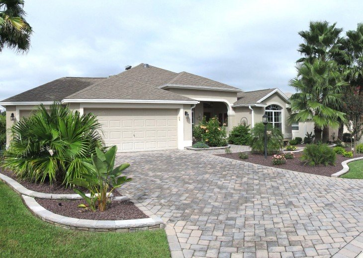 Front view of our home with 2 car + golf cart garage