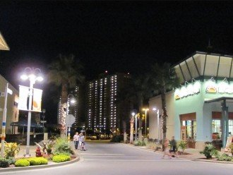 Night view of Calypso Resort from the middle of Pier Park