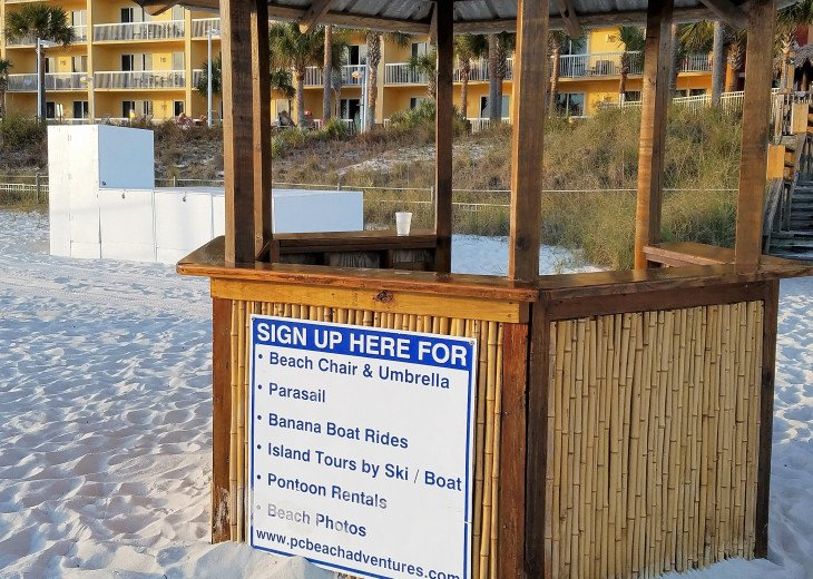 Beach hut to check in for your set of FREE beach chairs & umbrella service