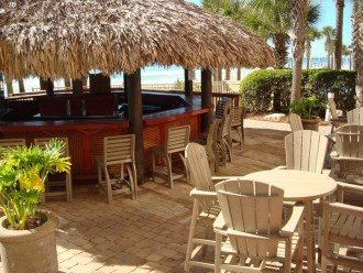 Calypso Resort Tiki Bar~ sits between the 2 beach side pools & the beach access