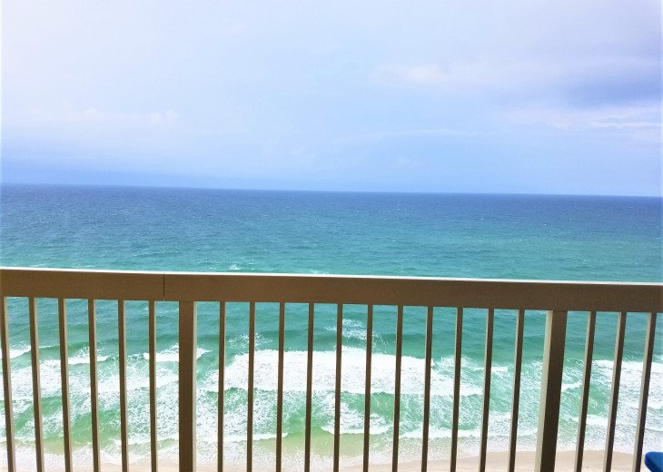 View of the rolling waves & powder white sand of the Gulf form your balcony