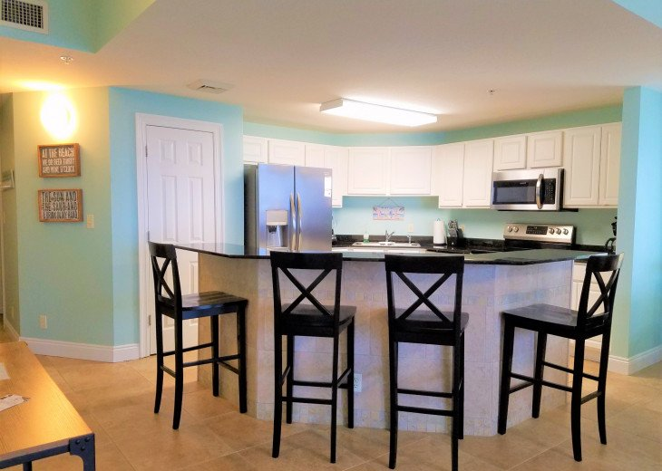 Open concept kitchen & large breakfast bar are inviting for social gatherings
