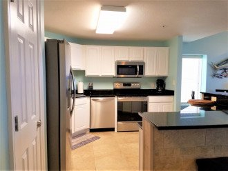 Stainless steel appliances~ full stocked kitchen w/storage & extra counter space